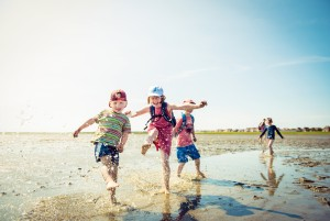 Children walking across the mudflats