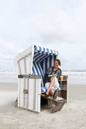 Relaxing in a wicker beach chair