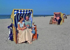 Cuddling up in a wicker beach chair beside the Baltic Sea.