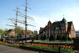 Brigg Friederike museum ship and the town hall in Papenburg