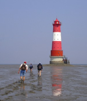 Walking on the mudflats near Arngast lighthouse