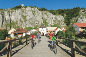 Superb cycling – Altmühl Valley Nature Park is one of Germany's most popular recreation areas and it is perfect for families; the cliff face near Essing can be seen in the background