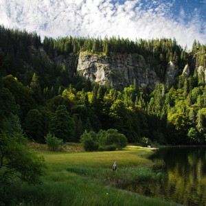 View of the cliff wall above Lake Feldsee at the foot of Mount Feldberg