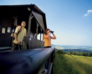 Thuringian Rhön, walkers with binoculars at walker's lodge