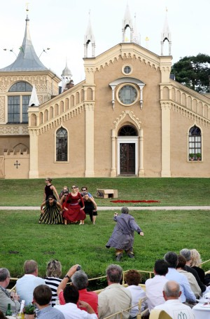 Theatre group in front of the Gothic House in the Garden Kingdom of Dessau-Wörlitz