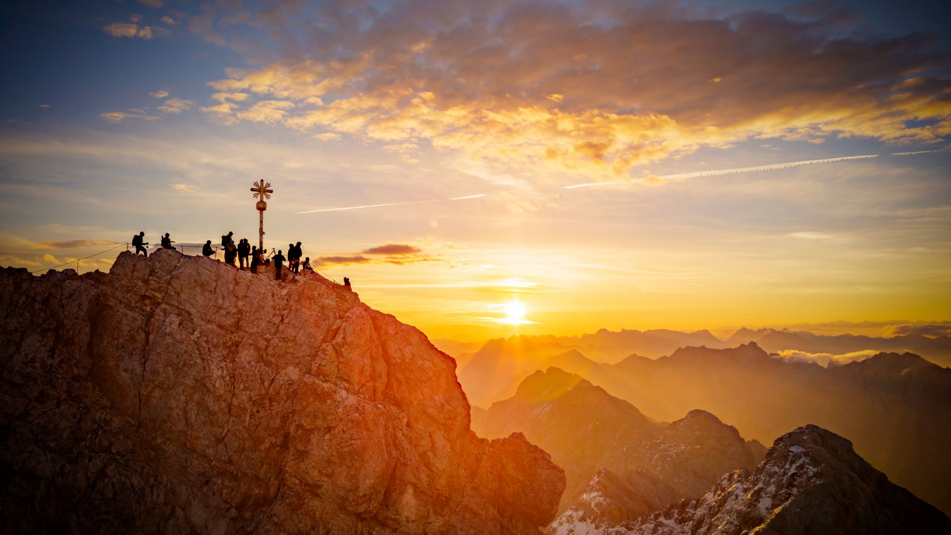 Zugspitze: summit of Mount Zugspitze, Germany's highest mountain in front of the rising sun.
