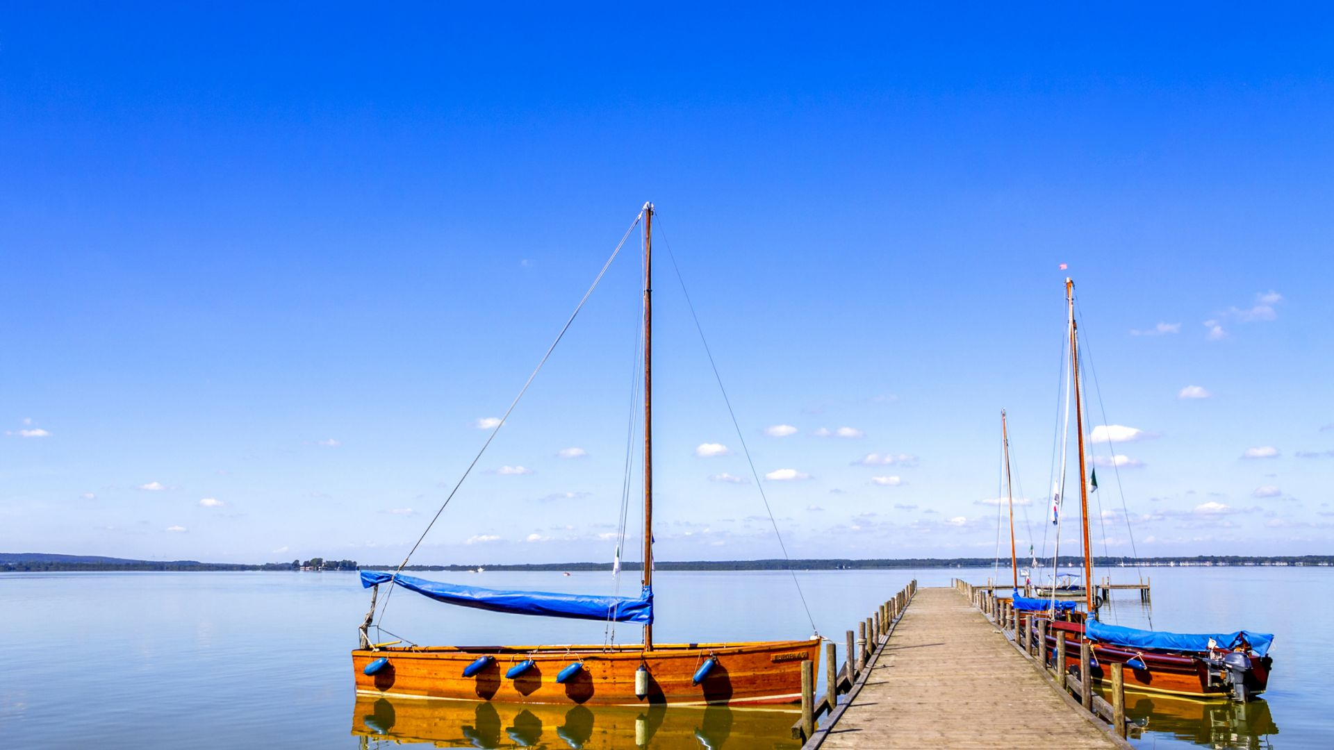 Steinhuder Meer with empty jetty and moored sailing boats