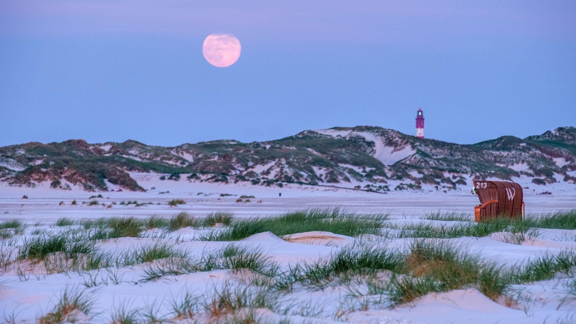 Amrum: full moon over the beach, light house, beach chair