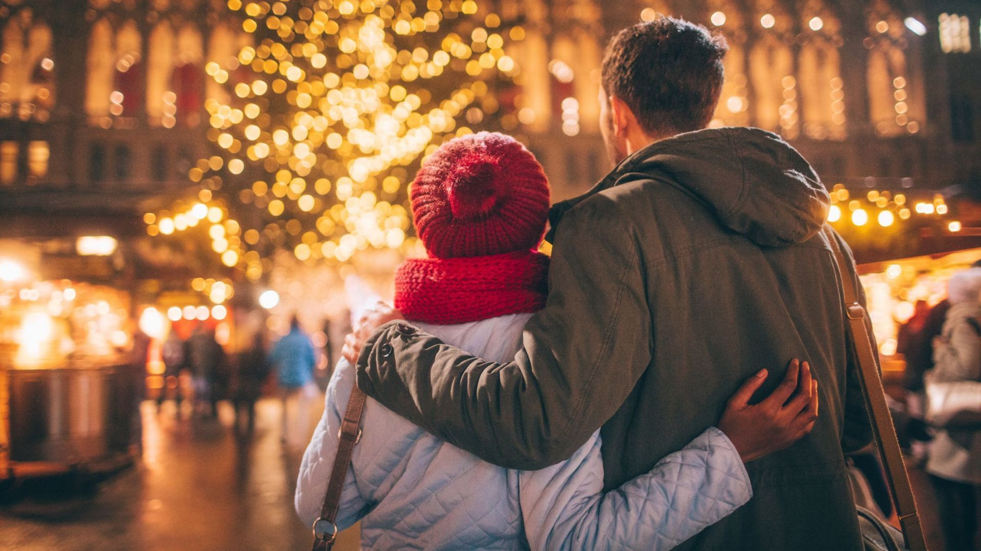 Christmas market, young couple in front of a christmas tree